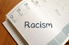 Racism write on notebook. Racism text concept write on notebook Royalty Free Stock Photos
