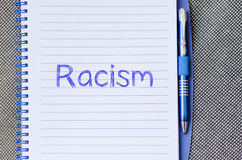 Racism write on notebook. Racism text concept write on notebook with pen Stock Photos