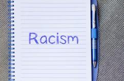 Racism write on notebook Stock Photos