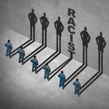 Racist Social Issue. Racist person concept as a group of people with one individual casting text showing racial prejudice or discrimination by an employee in a Royalty Free Stock Photography
