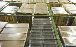 Rack. Stacker rack with numerous pallets royalty free stock photos