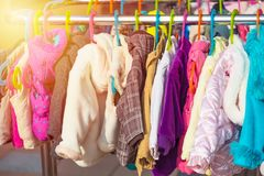 Rack of baby and children jackets displayed at outdoor hanger market for sale. Rack of baby and children jackets displayed at outdoor hanger market for sale Royalty Free Stock Photo