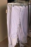 Rack of Baseball Pants Stock Images