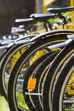 Rack of Bicycles. A rack of yellow bicycles Stock Image