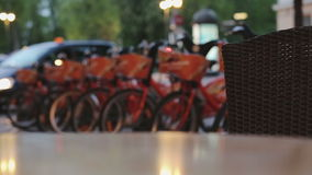 Rack of bikes in the city .Renting in Night Eastern Europe stock video