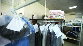 Rack with clean clothes at dry cleaners. View of rack with clean clothes at dry cleaners