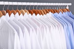 Rack with clean clothes on hangers. After dry-cleaning Royalty Free Stock Photo