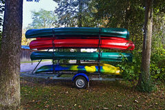 Rack of colorful canoes on a trailer Stock Images