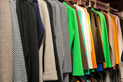 Rack of Colorful Garments Hanging on Rod Royalty Free Stock Photo