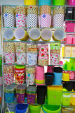 Rack of colorful household containers and basket. Stock Photography