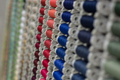 A rack of coloured threads. In the bobbin Royalty Free Stock Photography