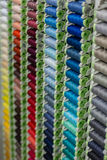 A rack of coloured threads Royalty Free Stock Images