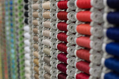 A rack of coloured threads. In the bobbin royalty free stock photo