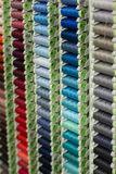 A rack of coloured threads Royalty Free Stock Photos