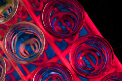 Rack of colourful test tubes Stock Photos