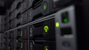 Rack data server with many hard drives and Green LED lamps Blink. Rack data server with many hard drives and Green LED lamps flashes stock footage