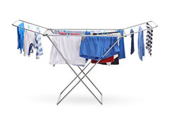 Rack dryer with clothes hanging Royalty Free Stock Photography