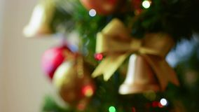 Rack focus Christmas ornaments and electric lights on tree stock video