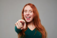 Rack focus on index finger of redhead young woman stock image