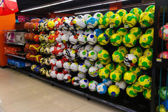 Rack full of footballs with colorful FIFA 2014 theme painting. Royalty Free Stock Image
