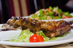 Rack of Grilled Pork Ribs on Plate in Restaurant Stock Images