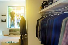 Rack with hangers man male clothes. Mannequin shop fashion Stock Images
