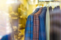 Rack with hangers man male clothes. Mannequin shop fashion Royalty Free Stock Photography