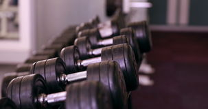 Rack of heavy black dumbbells Stock Photos