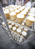 Rack with ice-cream ready for packing Royalty Free Stock Images