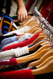 Rack of jumpers at market Royalty Free Stock Photography