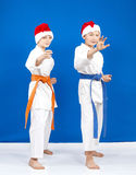 In rack of karate are athletes in the cap of Santa Claus Royalty Free Stock Photos