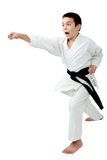 In rack of karate boy with a black belt beat a punch arm Royalty Free Stock Photo
