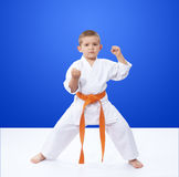 In rack is karate is standing athlete with an orange belt Royalty Free Stock Photography