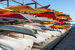 Rack with Kayaks and Canoes Stock Photos