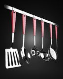 Rack of kitchen utensils Royalty Free Stock Photos