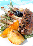 Rack of lamb. Close-up of sweet spicy rack of lamb cooked with fruits Stock Photography