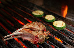 Rack of lamb being fried on grill Royalty Free Stock Image