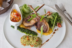 Rack of lamb with bulgur. And grilled vegetables Royalty Free Stock Photo