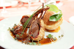 Rack of lamb with caramelized onions and bread Royalty Free Stock Images