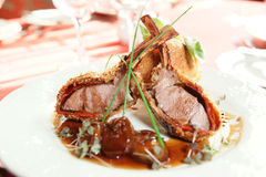 Rack of lamb with caramelized onions and bread Royalty Free Stock Photos