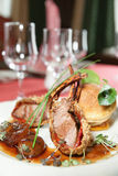 Rack of lamb with caramelized onions and bread Stock Images