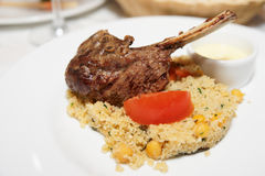Rack of lamb with couscous Stock Photos