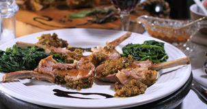 A rack of lamb in crusted mint sauce royalty free stock photography
