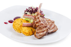 Rack of lamb dinner, with crushed roasted potatoes Stock Photo