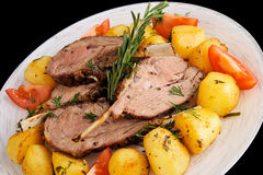 Rack of lamb with fried potatoes isolated on black Royalty Free Stock Photo