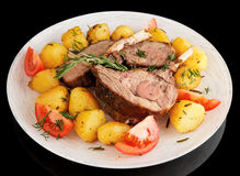 Rack of lamb with fried potatoes isolated on black Stock Images