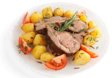 Rack of lamb with fried potatoes isolated on white Royalty Free Stock Images