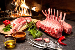 Rack of lamb in front of a fireplace Stock Photo