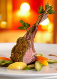 Rack of lamb in a herb crust. Stock Images