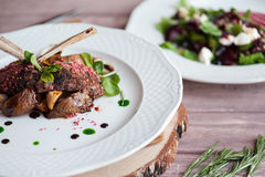 Rack of Lamb with mushrooms and roast potatoes Stock Photography